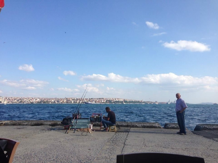 The Fisherman hard at work and an Old man walking beside the Bosphorus on a nice day.